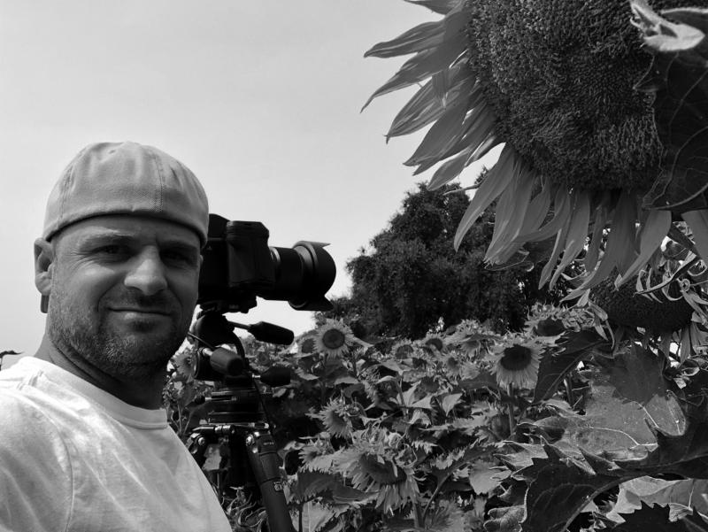 ian-and-sunflowers.jpg